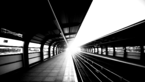 image of train station in black and white symbolizing missing the train by procrastinating with perfectionism
