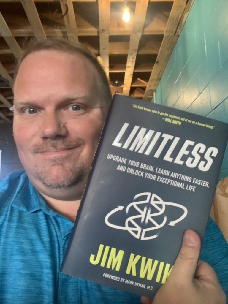 reading Liimitless book by Jim Kwik